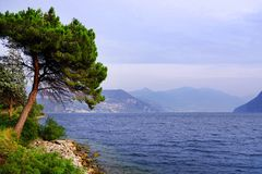 Lake Iseo, seen from its west bank. Lago d`Iseo or Sebino is the fourth largest lake in Lombardy, Italy, fed by the Oglio river. It is in the north of the stock photography