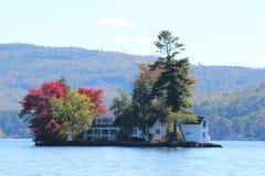 Lake Island cottage, in autumn Royalty Free Stock Image