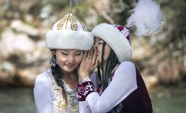 Young ladies dressed in traditional kyrgiz outfit stock photography