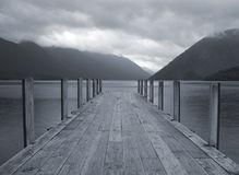 Lake jetty. Wooden lake jetty in the early morning mist Stock Photos
