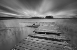Lake with jetty. long exposure landscape. Royalty Free Stock Photos