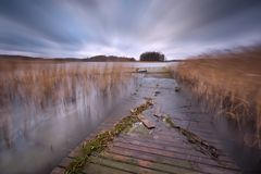 Lake with jetty. long exposure landscape. Royalty Free Stock Image