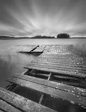 Lake with jetty. long exposure landscape. Royalty Free Stock Photo