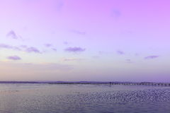 Lake with jetty at purple sky scenery Royalty Free Stock Photos
