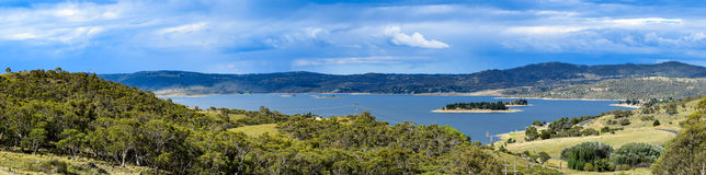 Lake Jindabyne landscape with overcast sky and rural foreground Stock Photography