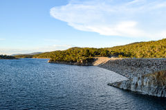 Lake Jindabyne in the shadows of mountain range and cloudscape Royalty Free Stock Images