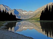 Lake Josephine Reflection. This lake reflection was taken in the Many Glacier area of Glacier National Park during the early morning hours Stock Photography
