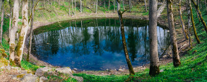 Lake in Kaali meteorite crater by springtime, Saaremaa Stock Images