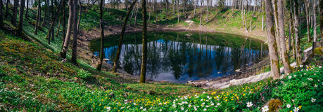 Lake in Kaali meteorite crater by springtime, Saaremaa Royalty Free Stock Photo