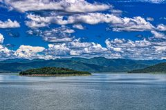Lake in Kaeng Krachan National Park in Thailand with hills. This unique picture shows the beautiful nature with hills and trees and the great reservoir in the royalty free stock photography