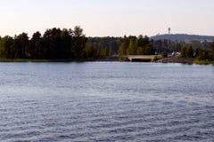 Lake Kallavesi, Kuopio Finland. Puijo tower and ski jumping hill on background royalty free stock photos