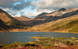Lake in Kamchatka. Lake on the Kamchatka Peninsula in the fall. sundown Stock Photo