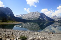 Lake in Kananaskis Country - Alberta - Canada. Lake in Kananaskis Country. Dead wood on the beach. Mountain reflection - Alberta - Canada Stock Photography
