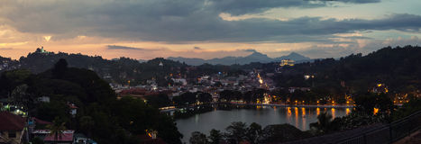 Lake in Kandy, Sri Lanka. Lake in Kandy. Sunset over the former capital of Sri Lanka. Panoramic view at night with car light trails royalty free stock photos