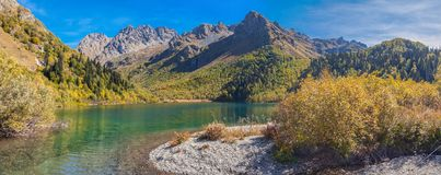 The source of the Mzymta River. Lake Kardyvach. Caucasian Biosphere Reserve. From the lake Kardyvach takes the beginning of the river Mzymta. The panorama shows royalty free stock photography