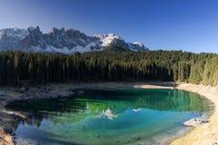 Lake Karersee in front of the mountain range Latemar Royalty Free Stock Photos