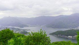 Lake kawachuchiko seeing from Mt. Tenjo. Lake kawachuchiko, Japan, with mountains and tress, seeing from Mountain Tenjo ropeway Royalty Free Stock Photo