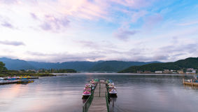 Lake Kawaguchiko with twilight sky on sunset time. YAMANASHI, JAPAN - OCTOBER 18: Kawaguchiko in Yamanashi, Japan on October 18, 2016. Hotels and resorts are royalty free stock images