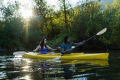 Lake Kayaking Couple stock images