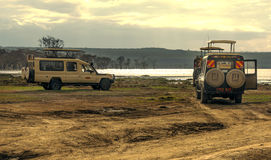 Lake of kenia with suv cars Royalty Free Stock Photos