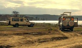Lake of kenia with suv cars Royalty Free Stock Photos