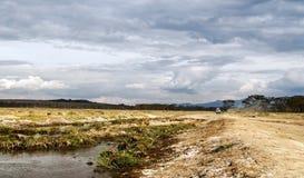 Lake of kenia with suv cars Royalty Free Stock Image