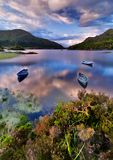 Lake in Killarney. Boats on water in Killarney National Park, Republic of Ireland, Europe Royalty Free Stock Images