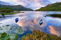Lake in Killarney. Boats on water in Killarney National Park, Republic of Ireland, Europe Stock Photos