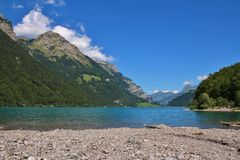 Beautiful place for swimming at lake Klontalersee, Switzerland. Royalty Free Stock Photography