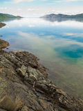 Lake Laberge, Yukon T, Canada, on calm summer day Stock Images