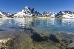 Lake Lac Blanc on the background of Mont Blanc massif. Alps. Lake Lac Blanc on the background of Mont Blanc massif. Alps Stock Image