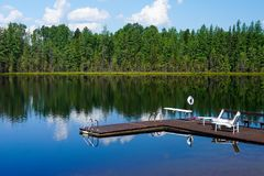 Lake Lac Perron Dock and chairs reflection royalty free stock photos