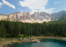 Lake Lago di Carezza in the Italian Dolomites at sunny summer day Stock Images