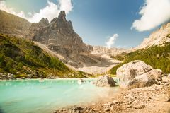 Lake Lago di Sorapis, Dolomites, Italy with blue sky, azure water and high mountains royalty free stock images