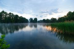 Lake. During rainy and cloudy sunrise Royalty Free Stock Image