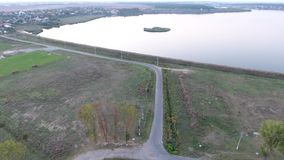 Lake and land seen from drone. Water and land seen from above stock footage