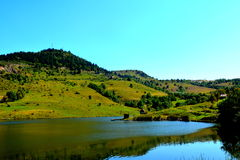 Lake and landcsape in Rosia Montana, Apuseni Mountains. Rosia Montana is a commune of Alba County in the Apuseni Mountains of western Transylvania, Romania.The Royalty Free Stock Photography