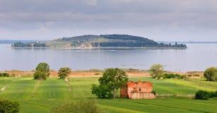 Lake Landscape. Landscape of old farmhouse, lake and island Royalty Free Stock Image