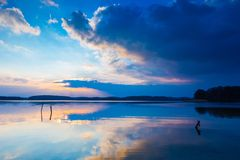 Lake landscape at colorful sunset Royalty Free Stock Photography