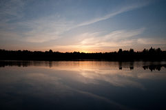 Lake landscape in evening. When sun going down Royalty Free Stock Photos