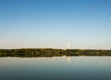 Lake landscape, a factory in distance Royalty Free Stock Photography