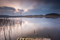Lake landscape in long time exposure Stock Photos