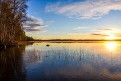 Lake landscape and rising sun South Savo stock image