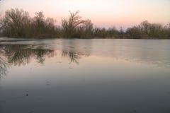 Lake landscape at sunset Stock Images