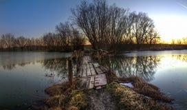 Lake landscape at sunset Stock Photos