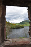 Lake landscape from a window view of ruined castle, Scotland Royalty Free Stock Photo