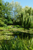 Lake in landscaped gardens Stock Image