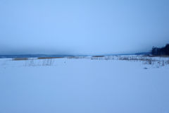 Lake landscapes with snow on the ice. Stock Images