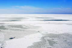 Lake landscapes with snow on the ice Stock Images