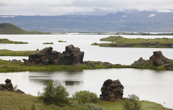 Lake, lava formations and mountains in Myvatn Iceland Stock Photo